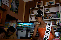 Salam, 19 years old, winner of the Miss Obama beauty pageant held at the Obama Cafe In Amhara's regional capital Bahir Dar waits for pictures of her to be printed by a  a local photographer's studio  on President Barack Obama's inauguration day, Tuesday January 20 2009..