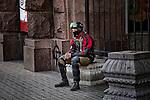A Pravni Sektor member waiting for instructions outside his party headquarter in Kiev, Ukraine.<br /> Combattente del Pravni Sektor attende gli ordini davanti alla sede del partito, Kiev, Ukraina.
