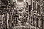 Sepia toned image of an alleyway in Valletta, Malta