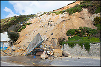BNPS.co.uk (01202)558833<br /> Pic: BNPS<br /> <br /> The scene of a huge landslip on the same cliffs further along the coast at Bournemouth in 2016.<br /> <br /> Plans have been unveiled for 28 eco-friendly beach huts to be built into a fragile seaside cliff to protect it from erosion.<br /> <br /> The timber-clad 'pods' will be erected on two tiers hallway up the 80ft sloping seaside cliff near to Sandbanks in Poole, Dorset.<br /> <br /> The stilts will act as pile foundations and be drilled into the ground to improve the stability of the cliff.<br /> <br /> Each beach hut will have its own balcony overlooking the sea and 140sq ft of floor space.<br /> Plans have been submitted to the local council to approve.