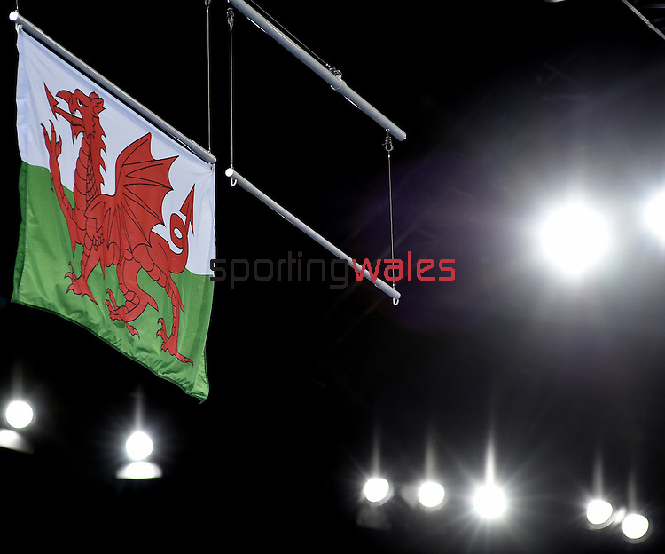 The Welsh flag is raised after Wales' Georgina Hockenhull won a bronco medal for her performance in the women's gymnastics artistic balance beam final<br /> <br /> Photographer Chris Vaughan/Sportingwales<br /> <br /> 20th Commonwealth Games - Day 9 - Friday 1st August 2014 - Gymnastics - SECC - Glasgow - UK
