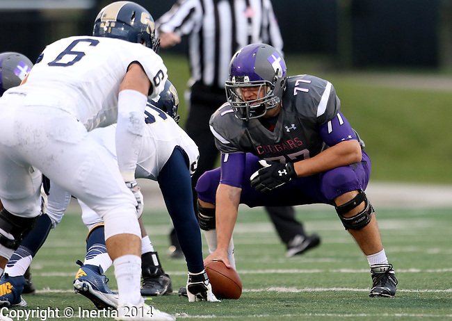 SIOUX FALLS, SD - OCTOBER 4: Center Trevor Wescott #77 from the University of Sioux Falls prepares to snap the ball against Concordia St. Paul in the first half of their game Saturday evening at Bob Young Field.(Photo by Dave Eggen/Inertia)