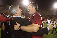 6 October 2007: Jim Harbaugh celebrates with Athletic Director Bob Bowlsby after Stanford's 24-23 win over the #1 ranked USC Trojans in the Los Angeles Coliseum in Los Angeles, CA.