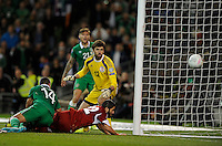 07/09/2015; UEFA Euro 2016 Group D Qualifier - Republic of Ireland v Georgia, Aviva Stadium, Dublin. <br /> Ireland&rsquo;s Jon Walters scores a goal despite the tackle attempt from Giorgi Navalovski of Georgia.<br /> Picture credit: Tommy Grealy/actionshots.ie.