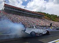 Jun 21, 2015; Bristol, TN, USA; NHRA funny car driver Tim Wilkerson during the Thunder Valley Nationals at Bristol Dragway. Mandatory Credit: Mark J. Rebilas-