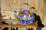 Rusty blue enamel tea pot on rusty stove, Goldfield, Nev.