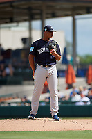 New York Yankees relief pitcher Albert Abreu (87) looks in for the sign during a Grapefruit League Spring Training game against the Detroit Tigers on February 27, 2019 at Publix Field at Joker Marchant Stadium in Lakeland, Florida.  Yankees defeated the Tigers 10-4 as the game was called after the sixth inning due to rain.  (Mike Janes/Four Seam Images)