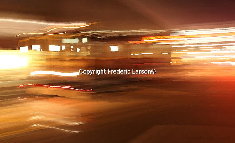 A San Francisco Cable Car climbs up California Street at night.