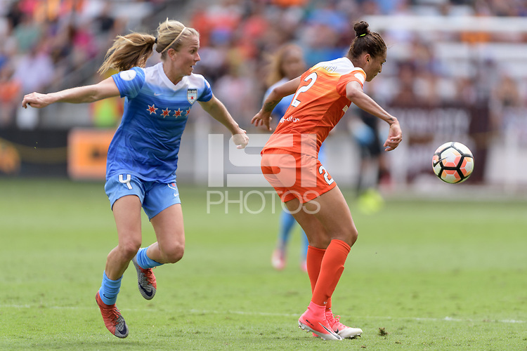 Houston, TX - Saturday April 15, 2017: Poliana attempts to gain control of a loose ball in front of Alyssa Mautz during a regular season National Women's Soccer League (NWSL) match won by the Houston Dash 2-0 over the Chicago Red Stars at BBVA Compass Stadium.