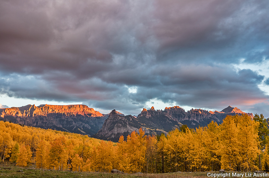 Uncompahgre National Forest, Colorado: Storm clouds over the cliffs of the Cimarron with fall colored hillsides at sunset , San Juan Mountains