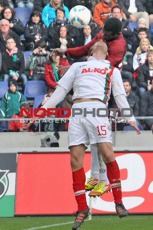 03.03.2012, AWD Arena, Hannover, GER, 1.FBL, Hannover 96 vs FC Augsburg, im Bild <br /> <br /> Han96 Spieler Mame Biram Diouf #39 k&ouml;pft gegen Sebastian Langkamp #15 das 2:1.i<br /> <br />  // during the Match GER, 1.FBL, Hannover 96 vs FC Augsburg,  AWD Arena, Hannover, Germany, on 2012/03/03,<br /> Foto &copy; nph / Rust
