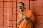 Mature hispanic man with ipod, smiling