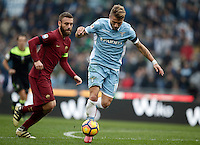 Calcio, Serie A: Lazio vs Roma. Roma, stadio Olimpico, 4 dicembre 2016.<br /> Lazio's Ciro Immobile, right, is chased by Roma&rsquo;s Daniele De Rossi during the Italian Serie A football match between Lazio and Rome at Rome's Olympic stadium, 4 December 2016. Roma won 2-0.<br /> UPDATE IMAGES PRESS/Isabella Bonotto