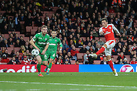 Mesut Ozil of Arsenal (right) scores his third hatrick goal against Ludogorets Razgrad to make it 6-0 during the UEFA Champions League match between Arsenal and PFC Ludogorets Razgrad at the Emirates Stadium, London, England on 19 October 2016. Photo by David Horn / PRiME Media Images.