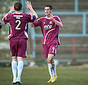 Alloa's Calum Elliot (9) is congratulated by Alloa's James Doyle (2) after he scores their third goal.