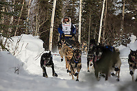 Martin Buser on the trail after leaving the restart of the Iditarod sled dog race in Willow, Alaska Sunday, March 3, 2013.
