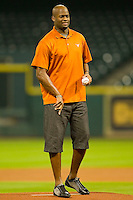 Former Texas Longhorns quarterback Vince Young calls for a fastball as he prepares to throw out the ceremonial first pitch prior to the game between the Texas Longhorns and the Rice Owls at Minute Maid Park on March 2, 2012 in Houston, Texas.  Brian Westerholt / Four Seam Images