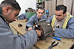 Young men work on an electrical motor in a vocational training center in al-Qarara, in the Gaza Strip. Sponsored by the Near East Council of Churches Committee for Refugee Work, part of the ACT Alliance, the center trains youth in residential and industrial electrical work..