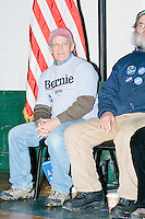 Sanders supporters Greg Raymond, of Peterborough, (left) and Gordon Webber, of Antrim, sit behind the candidate as Vermont senator and Democratic presidential candidate Bernie Sanders speaks to senior citizens at the Peterborough Community Center gymnasium in Peterborough, New Hampshire.