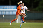 20 October 2013: Clemson's Paige Reckert (left) and North Carolina's Megan Brigman (3) challenge for a header. The University of North Carolina Tar Heels hosted the University of Virginia Cavaliers at Fetzer Field in Chapel Hill, NC in a 2013 NCAA Division I Women's Soccer match. North Carolina won the game 2-0.
