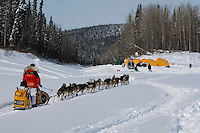 Mitch Seavey arrives at the Eagle Island checkpoint on the Yukon river Saturday afternoon.   Eagle Island is a remote tent checkpoint.  Iditarod 2009