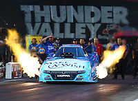 Jun 19, 2015; Bristol, TN, USA; NHRA funny car driver Tommy Johnson Jr during qualifying for the Thunder Valley Nationals at Bristol Dragway. Mandatory Credit: Mark J. Rebilas-