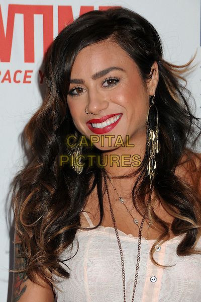 """SARA BETTENCOURT.Premiere of Showtime's New Reality Series """"The Real L Word""""  Held At East West Lounge, West Hollywood, California, USA..June 1st, 2011.headshot portrait white top earrings tattoos red lipstick make-up beauty .CAP/ADM/BP.©Byron Purvis/AdMedia/Capital Pictures."""