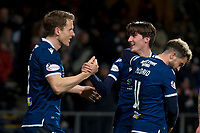 10th March 2020; Dens Park, Dundee, Scotland; Scottish Championship Football, Dundee FC versus Ayr United; Oliver Crankshaw of Dundee is congratulated after scoring in the 91st minute for 2-0 by Christophe Berra and Declan McDaid