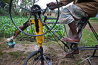 A man operates bicycle pump to irrigate his corn field. These bicycle powered pumps were developed in Bangladesh. They allow for small-scale irrigation and are particularly useful to poor farmers that can not afford diesel-powered pumps. (Photo by Tadej Znidarcic)