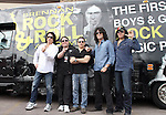 SIOUX FALLS, SD - JULY 20: KISS members Paul Stanley, Eric SInger, Tommy Thayer, and Gene Simmons along with founder Chuck Brennan pose for a photograph outside the bus at the Brennan Rock & Roll Academy Saturday afternoon in Sioux Falls.  (Photo by Dave Eggen/Inertia)