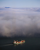 aerial photograph loaded containership under fog San Francisco bay