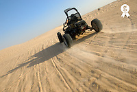 Beach buggy speeding across desert (Licence this image exclusively with Getty: http://www.gettyimages.com/detail/sb10065474cl-001 )