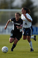 Tiffeny Milbrett of the New York Power beats Joy Fawcett of the San Diego Spirit during their May 25th game at Mitchel Athletic Complex. Milbrett had two assists during the Power's 2-1 win.