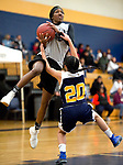 WATERBURY, CT-120818JS13- WCA's Leila Lazaro Aniyyah Watson (13) gets fouled by Kennedy's Amaryllies Rivera (20) while driving to the basket during their Waterbury girls basketball jamboree game Saturday at Kennedy High School. <br /> Jim Shannon Republican American