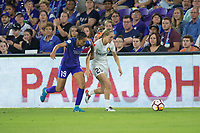 Orlando, FL - Saturday March 24, 2018: Orlando Pride defender Poliana Barbosa Medeiros (19) and Utah Royals forward Brittany Ratcliffe (25) race for a ball during a regular season National Women's Soccer League (NWSL) match between the Orlando Pride and the Utah Royals FC at Orlando City Stadium. The game ended in a 1-1 draw.