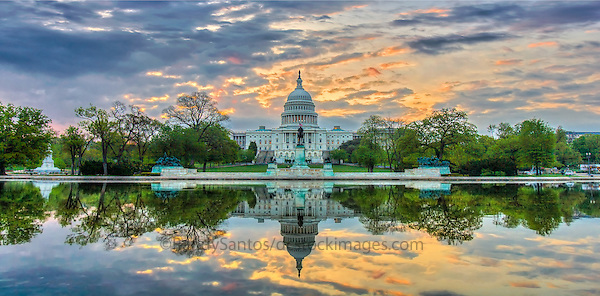 US Capitol Building Washington DC - Washington DC Stock Photography<br /> The United States Capitol Building is located on Capitol Hill at the east end of the National Mall in Washington DC.  The US Capitol is among the most symbollically important and architecturally impressive buildings in the United States. It has housed the meeting chambers of the US House of Representatives and US Senate for two centuries.  An example of 19 century neo-claccical architecture.  Architectural details include columns, porticos, arches, steps, the US Capitol dome and rotunda.  A washington D.C. landmark and national icon it is a popular tourist attraction and travel destination in Washington DC.