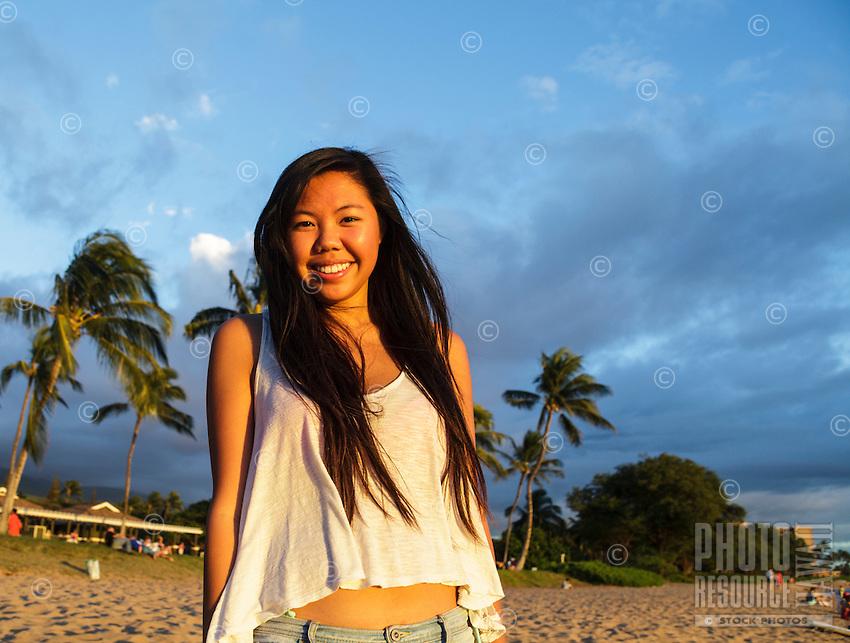 A smiling young woman at North Ka'anapali Beach (or Airport Beach), West Maui.