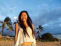 A smiling young woman at North Ka'anapali Beach (or Airport Beach), West Maui.