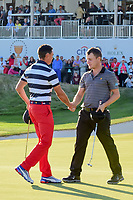 Rickie Fowler (USA) and Emiliano Grillo (ARG) shake hands following their match during round 4 Singles of the 2017 President's Cup, Liberty National Golf Club, Jersey City, New Jersey, USA. 10/1/2017. <br /> Picture: Golffile | Ken Murray<br /> <br /> All photo usage must carry mandatory copyright credit (&copy; Golffile | Ken Murray)