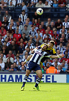 Pictured:  Ben Davies of Swansea heads the ball over Shane Long of West Brom. Sunday 01 September 2013<br />