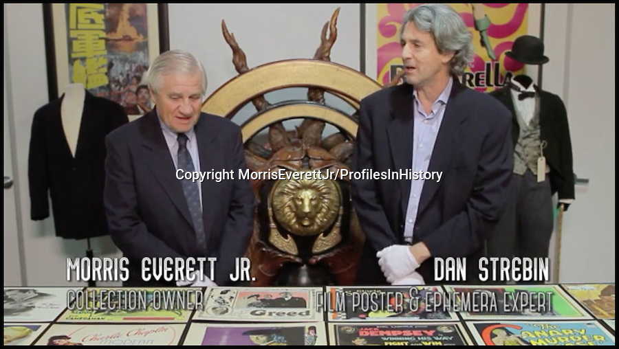 BNPS.co.uk (01202 558833)<br /> PIc: MorrisEverettJr/ProfilesInHistory/BNPS<br /> <br /> ***Please Use Full Byline***<br /> <br /> Morris Everett Jr (left) and Dan Strebin, film poster and ephemera expert at Profiles in History.<br /> <br /> The world's largest collection of movie posters boasting artwork from almost every single film ever made has gone on sale for a staggering £15 million.<br /> <br /> The colossal archive features 196,000 posters from more than 44,000 films which have been made since the birth of cinema in the early 1900s and has been singlehandedly pieced together by one avid collector over the last 50 years.<br /> <br /> Morris Everett Jr has dedicated his life's work to seeking out original posters from every English-speaking film ever made and compiling them into a comprehensive library.<br /> <br /> The collection is tipped to make $20 million - around £15 million pounds - when it goes under the hammer in a series of auctions at Californian saleroom Profiles in History.<br /> <br /> The first auction, featuring 1,400 lots, takes place on June 29 and 30 in Calabasas.