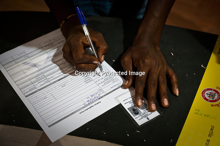 Residents fill up the Unique Identity (UID) form during the national identity enrollment process in Mysore city in Karnataka. Photograph: Sanjit Das/Panos