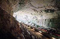 peloton rolling through a spectacular huge/dark cave: the 'Grotte du Mas-d'Azil'<br /> <br /> Stage 16: Carcassonne &gt; Bagn&egrave;res-de-Luchon (218km)<br /> <br /> 105th Tour de France 2018<br /> &copy;kramon