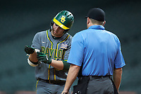 Andy Thomas (25) of the Baylor Bears shows home plate umpire Clint Fagan where he feels he was hit by a pitch during the game against the Arkansas Razorbacks in game nine of the 2020 Shriners Hospitals for Children College Classic at Minute Maid Park on March 1, 2020 in Houston, Texas. The Bears defeated the Razorbacks 3-2. (Brian Westerholt/Four Seam Images)