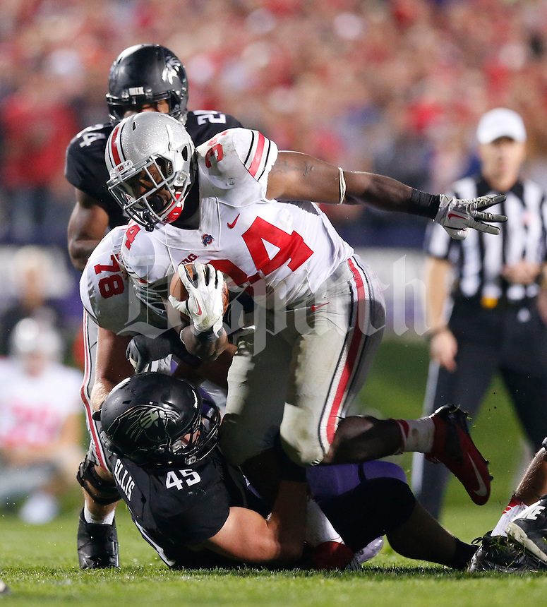 Ohio State Buckeyes running back Carlos Hyde (34) is tackled by Northwestern Wildcats linebacker Collin Ellis (45) during Saturday's NCAA Division I football game at Ryan Field in Evanston on October 5 2013. (Barbara J. Perenic/The Columbus Dispatch)