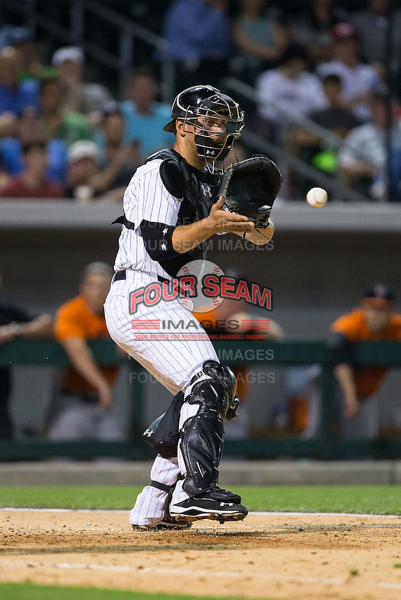 Charlotte Knights catcher Kevan Smith (32) fields a throw at home plate during the game against the Norfolk Tides at BB&T BallPark on April 9, 2015 in Charlotte, North Carolina.  The Knights defeated the Tides 6-3.   (Brian Westerholt/Four Seam Images)