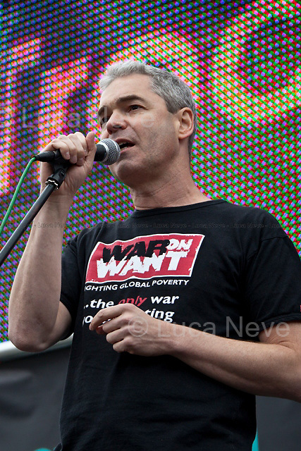 John Hilary (Executive director of War on Want).<br /> <br /> London, 08/10/2011. Today Trafalgar Square was the stage of the &quot;Antiwar Mass Assembly&quot; organised by The Stop The War Coalition to mark the 10th Anniversary of the invasion of Afghanistan. Thousands of people gathered in the square to listen to speeches given by journalists, activists, politicians, trade union leaders, MPs, ex-soldiers, relatives and parents of soldiers and civilians killed during the conflict, and to see the performances of actors, musicians, writers, filmmakers and artists. The speakers, among others, included: Jeremy Corbin, Joe Glenton, Seumas Milne, Brian Eno, Sukri Sultan and Shadia Edwards-Dashti, Hetty Bower, Mark Cambell, Sanum Ghafoor, Andrew Murray, Lauren Booth, Kate Hudson, Sami Ramadani, Yvone Ridley, Mark Rylance, Dave Randall, Roger Lloyd-Pack, Rebecca Thorn, Sanasino al Yemen, Elvis McGonagall, Lowkey (Kareem Dennis), Tony Benn, John Hilary, Bruce Kent, John Pilger, Billy Hayes, Alison Louise Kennedy, Joan Humpheries, Jemima Khan, Julian Assange, Lindsey German, George Galloway. At the end of the speeches a group of protesters marched toward Downing Street where after a peaceful occupation the police made some arrests.