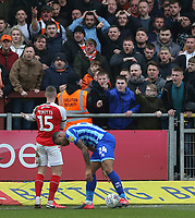 Fleetwood Town's Paul Coutts confronts the Blackpool fans<br /> <br /> Photographer Lee Parker/CameraSport<br /> <br /> The EFL Sky Bet League One - Fleetwood Town v Blackpool - Saturday 7th March 2020 - Highbury Stadium - Fleetwood<br /> <br /> World Copyright © 2020 CameraSport. All rights reserved. 43 Linden Ave. Countesthorpe. Leicester. England. LE8 5PG - Tel: +44 (0) 116 277 4147 - admin@camerasport.com - www.camerasport.com