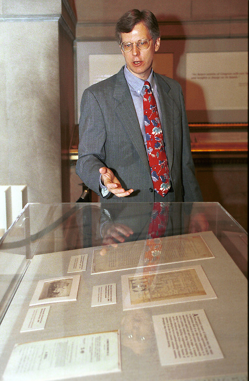 RC20000120-104-TW: 01/20/00: Curator of the Treasures of Congress exhibit at the National Archives, Bruce Bustard, explains historical documents to reporters..    Tom Williams/Roll Call