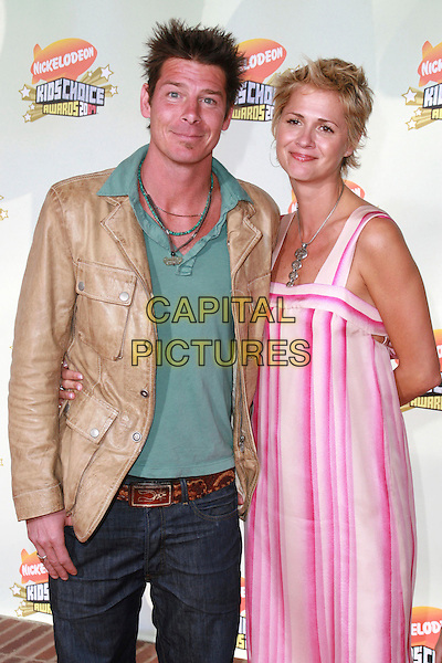 TY PENNINGTON & DREA BOCK.20th Annual Nickelodeon Kids' Choice Awards held at UCLA's Pauley Pavilion, Westwood, California, USA..March 31st, 2007.half length pink striped stripes dress beige jacket.CAP/ADM/CH.©Charles Harris/AdMedia/Capital Pictures